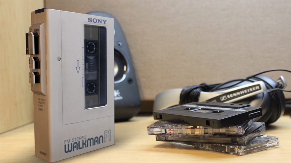 SONY WALKMAN modeled, textured, rendered, and composited in background.
