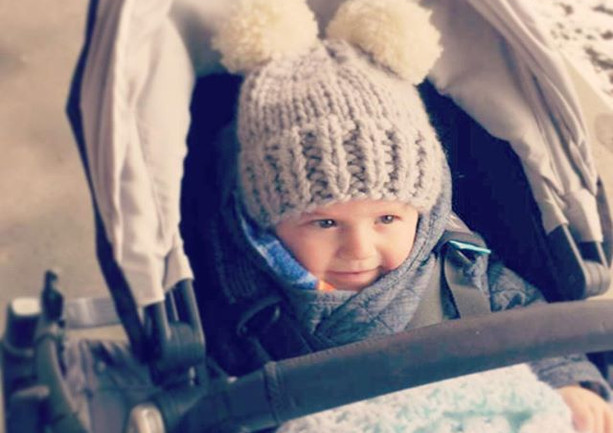 little cubs in our double pom hat out on