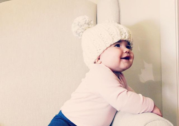 how cute is baby Viv in our double pom h
