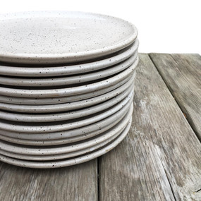 Stack of white collection plates