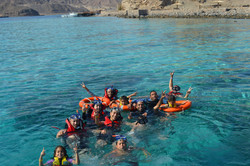 snorkeling group chilling in water