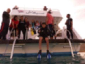 Preparing for a dive in Aqua Sport Taba