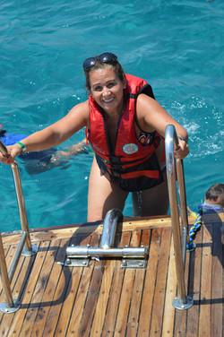 snorkeler climbing back on taba boat