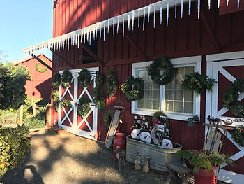 Frog Pond Farm Barn decorated with wreaths and snowmen