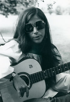 Young Karen Littman playing guitar