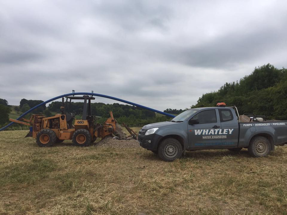 Our chain digger on site with one of our