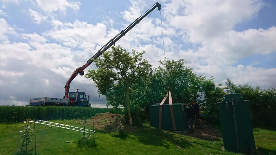 Lifting a water storage tank in to place