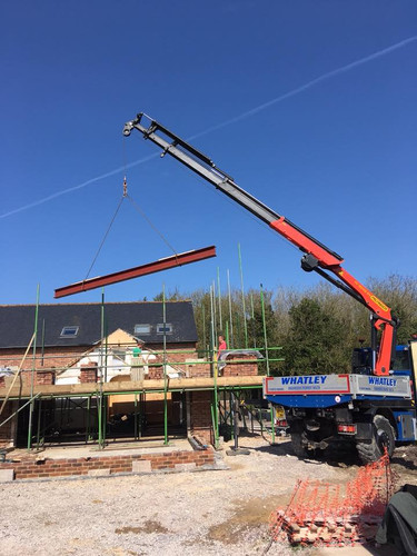 Our Unimog crane lifting steel beams in