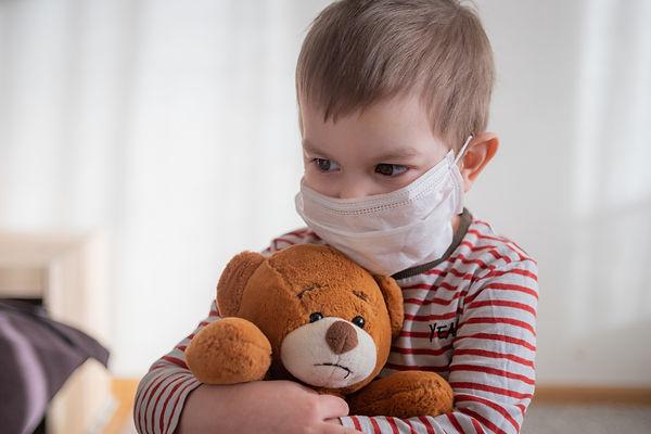 boy with teddy and mask.jpeg