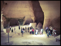 People gathering in the Bell Caves.