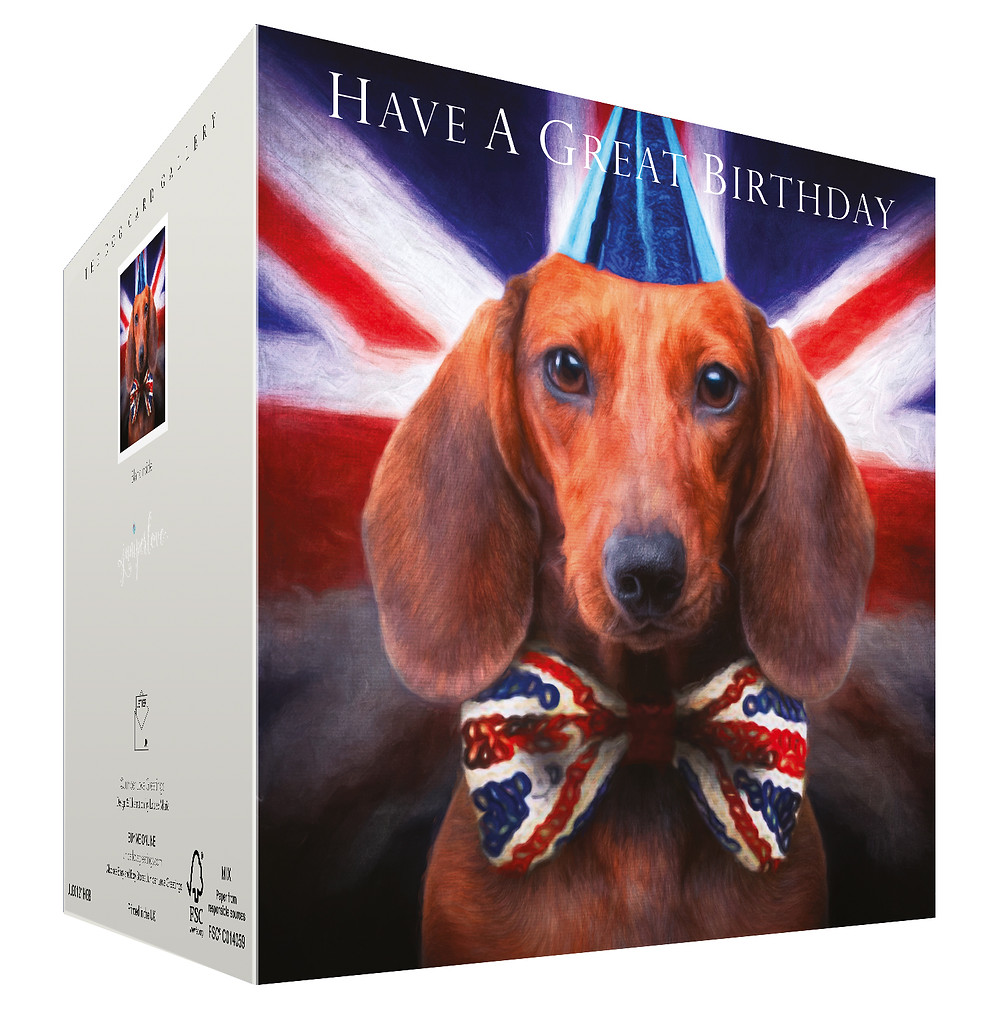 dachshund dog birthday card by Juniperlove greetings features a cute sausage dog wearing a party hat and bowtie with Union Jack flag and has the text have a great birthday on the front for uk and worldwide delivery