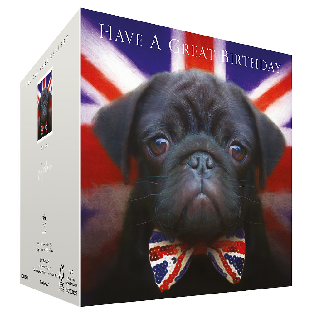 Black pug puppy wearing Union Jack bow tie with flag in background