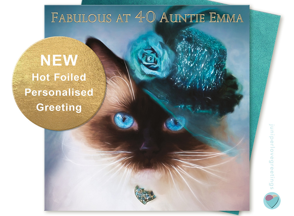 Birthday card with close up of seal fitted ragdoll cats face wearing a pretty teal hat