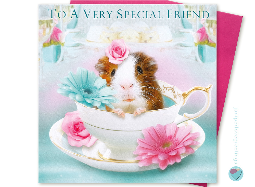 birthday card with a picture of a guinea pig sitting in a vintage style tea cup with flowers on the front