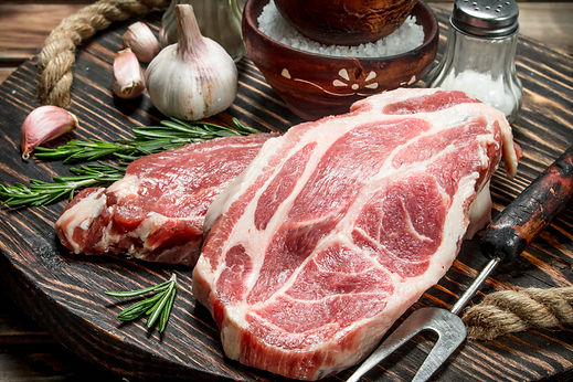 raw-steaks-from-juicy-pork-57KEGBX.jpg