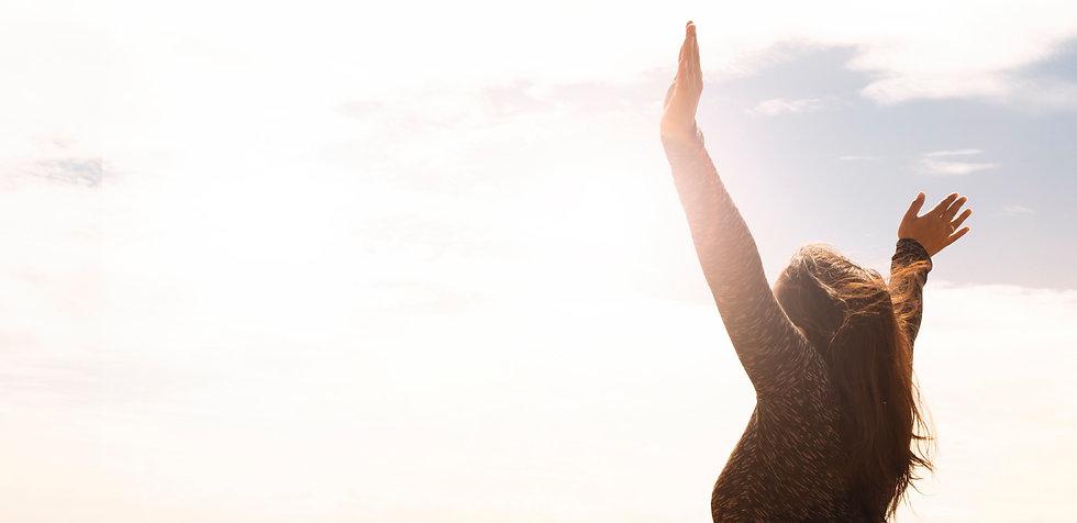 photo-of-woman-raising-both-hands-1556691_edited.jpg