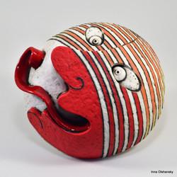red mask ceramic