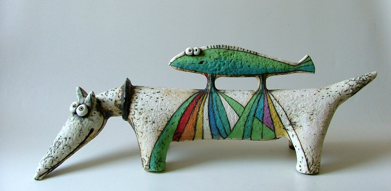 dog and fish sculpture