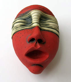 red face mask wall decor