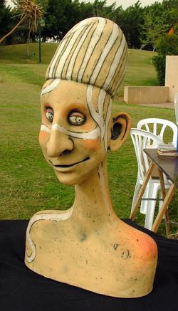 yellow face sculpture