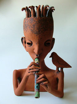 boy with the flute sculpture