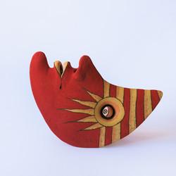 half moon red ceramic object