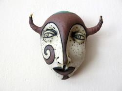 brown ceramic mask