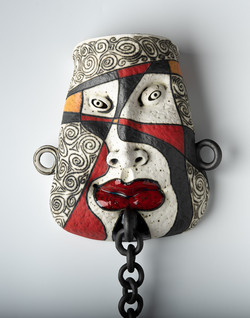 hand made ceramic mask angry face with a chain