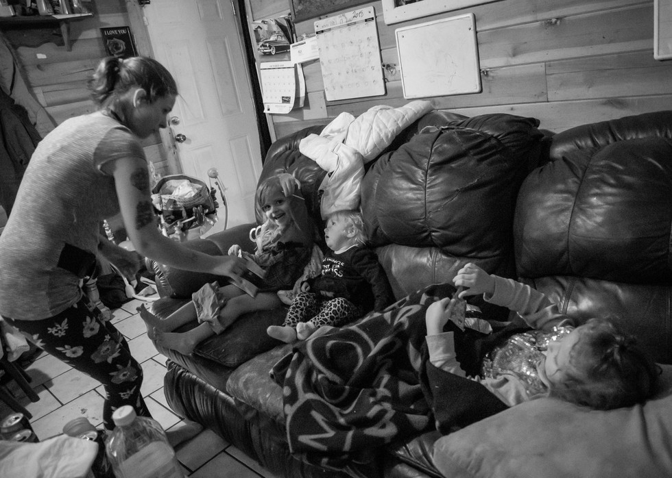 Hailey (left to right) and her children, Darlene, Nova and Malinzea, wait for son Terence to get home from school. In the meantime, Hailey grabbed the girls a snack and some pants for Darlene.