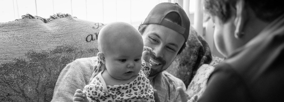 Jeremy Hawkins, 27 holds up his daughter, Ruby, during an assessment by Lisa. Jeremy and his wife, Tifany, live with her parents.