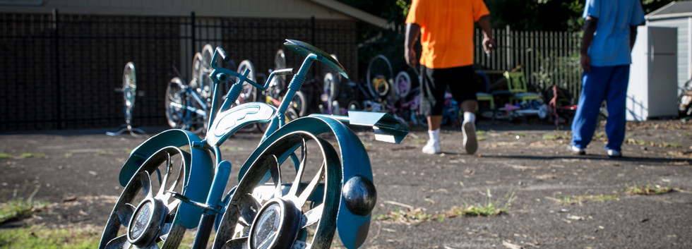 """Key and Abde prouse the Delway bike lot, taking inventory. """"It's just a day in the life of fixing bikes."""""""