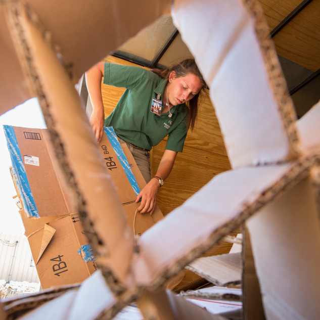 A Ranger at the Philmont Scout Ranch takes part in a service day. This one invovled the rangers being dispatched to assist with the camps recycling operation.