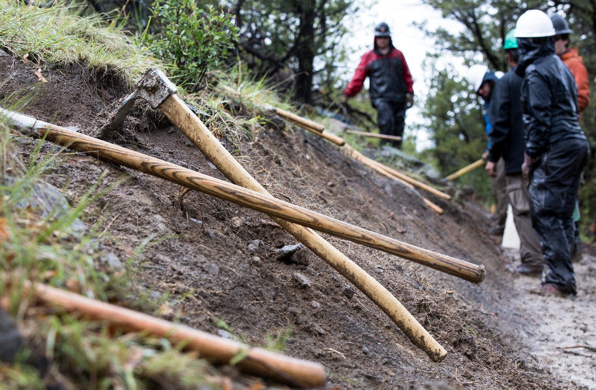 During the All Cons Conservation Project on the Philmont Scout Ranch, conservationists braved the rain and slick terrain as they continued to build trails.