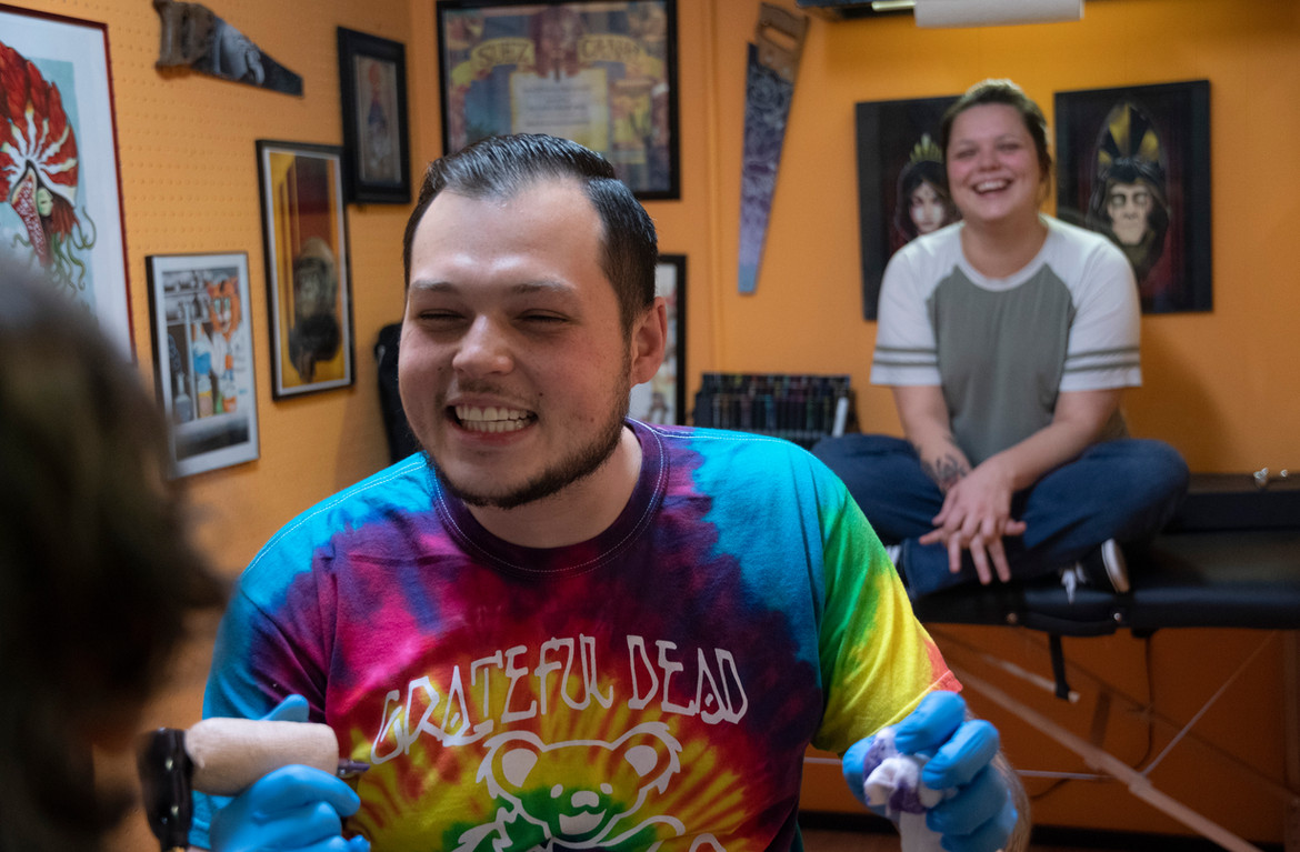 """Corey B. Bailey of Screaming Aces Tattoo tells a client about the time he tattooed a guy named """"Smiley"""""""