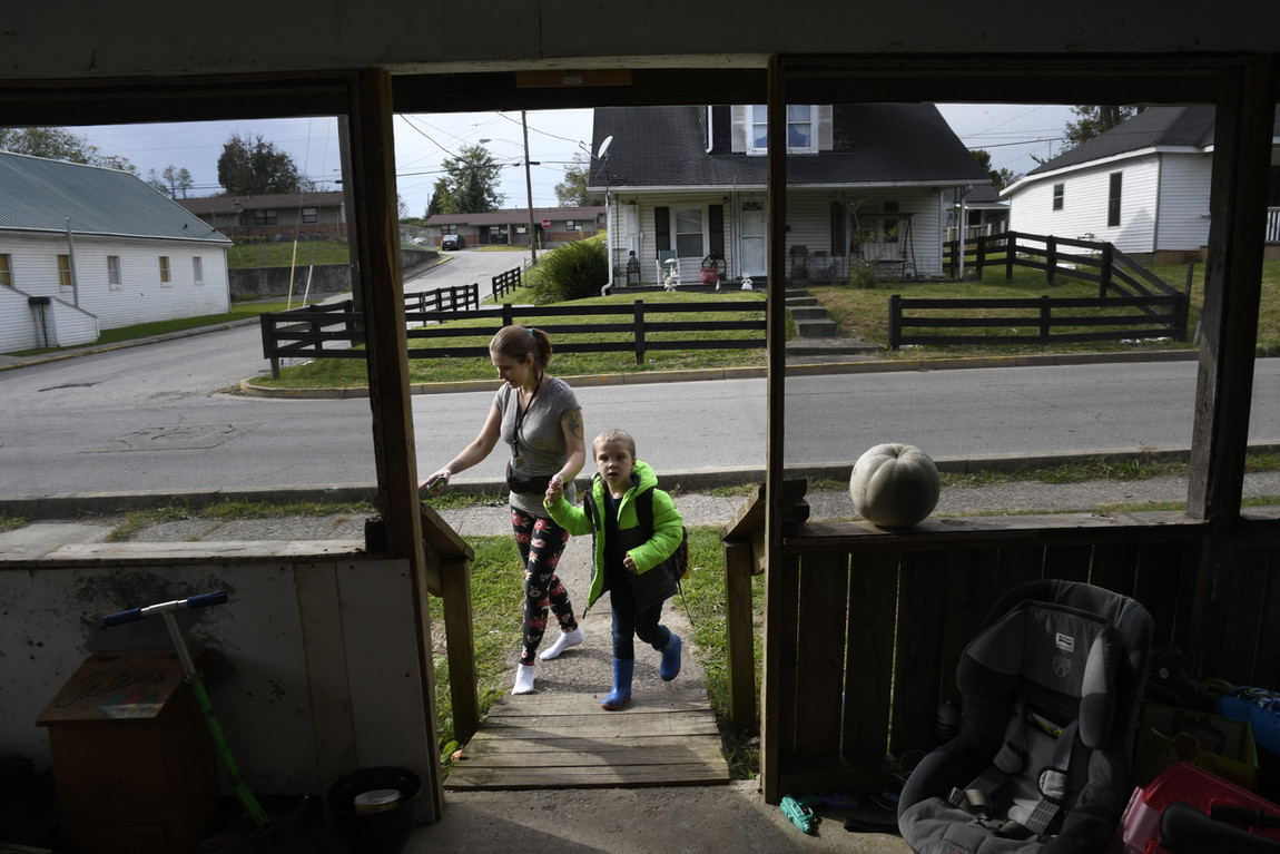 Hailey walks her son Terence home from the school bus. He is one of her four children. It can be a lot to deal with, but Hailey is determined to give her children the best life she can.
