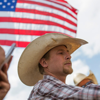 Media and Photo Services Photographer, Evan Mattingly interviews a rodeo cowboy during Cimarrons annual July 4th Rodeo.