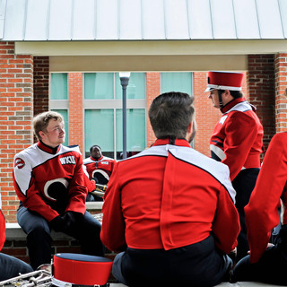 Western Kentucky University Marching Band members take a break after performing on the Avenue of Champions before the homecoming game.