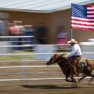 During the national anthem performed at Cimaron's 2017 4th of July Rodeo, a rider brandishes the stars and stripes.