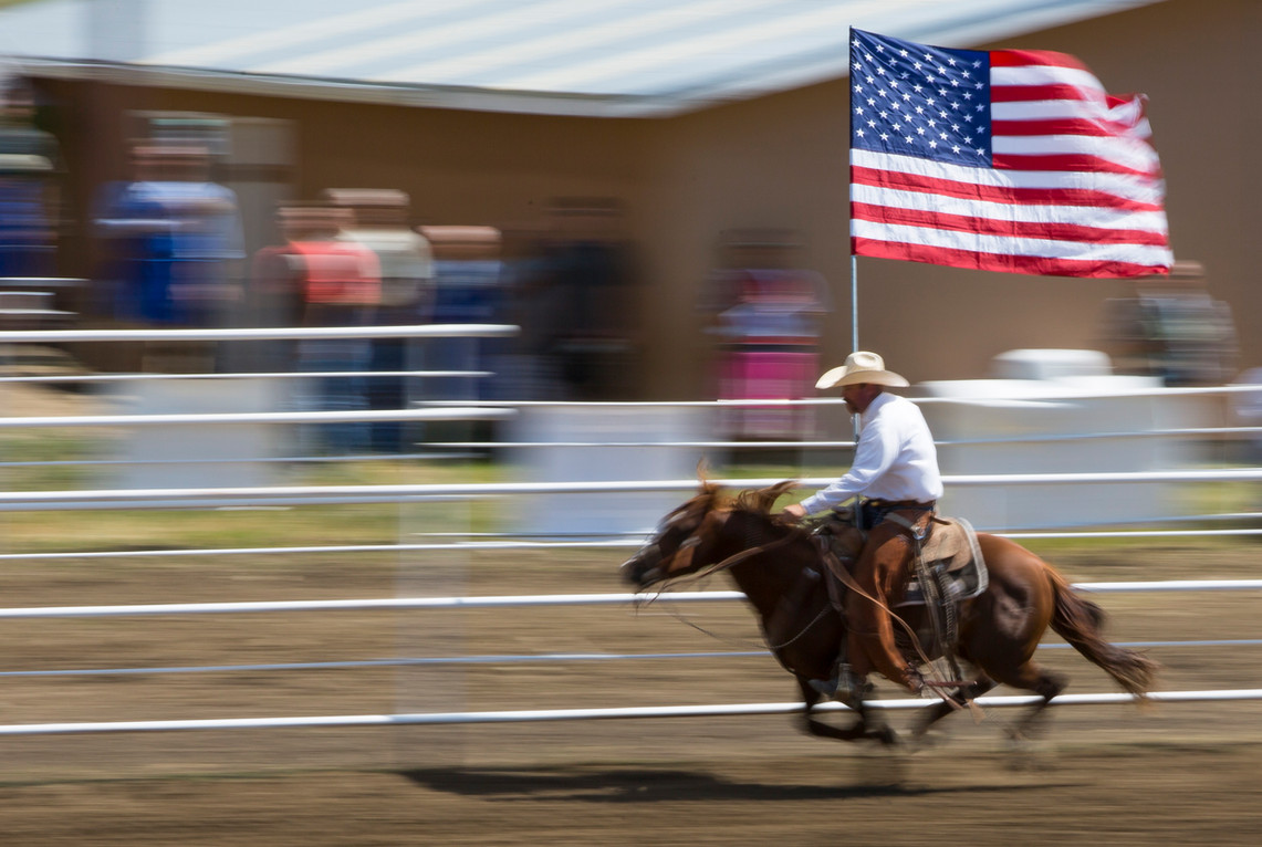 The Stars and Stripes are displayed at the Maverick Club Rodeo on the 4th of July