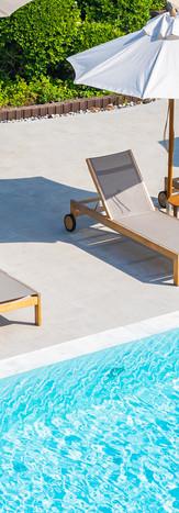umbrella-and-deck-chair-around-outdoor-s
