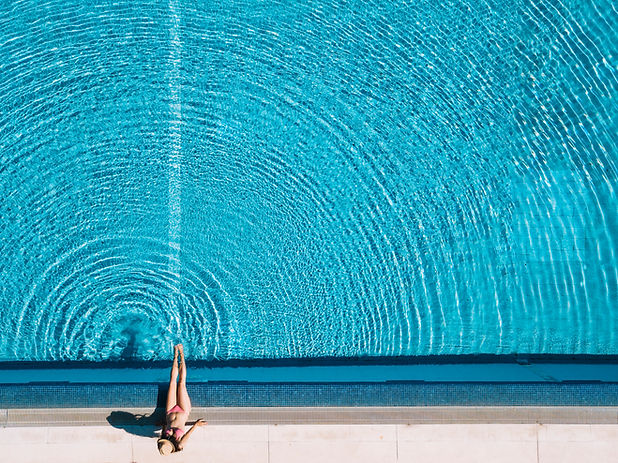 top-view-of-girl-relaxing-next-to-pool.j