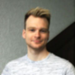 Headshot White Background.jpg
