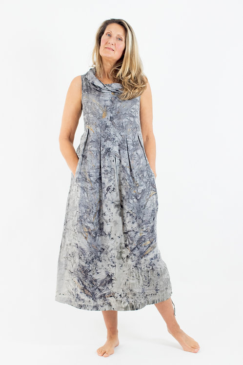 Long sleeveless linen cowl neck dress with box pleats, pockets and side draw