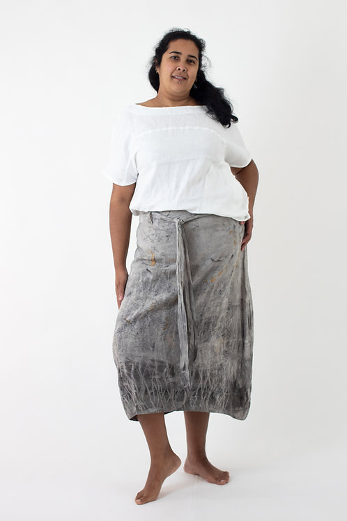 Ankle length linen skirt with side tucks, curved hemline, belt and cotton lining