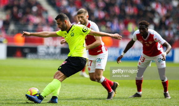 Reims vs Lille players tackling for the ball in a past match
