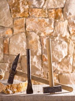 Hammer mason tools of stonecutter masonr