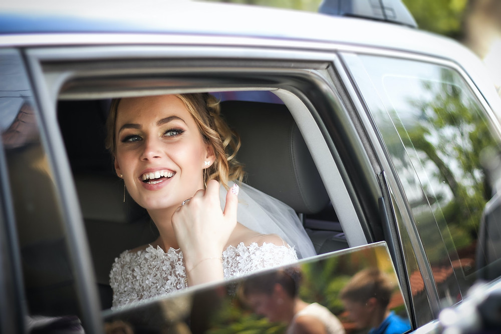 bride in car on the way to church