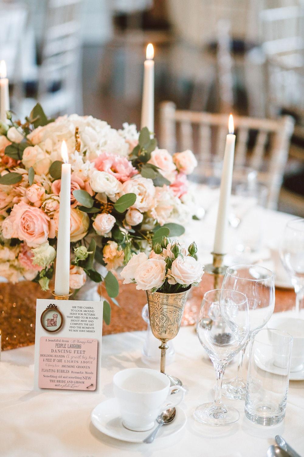 flowers on a gold wedding reception table