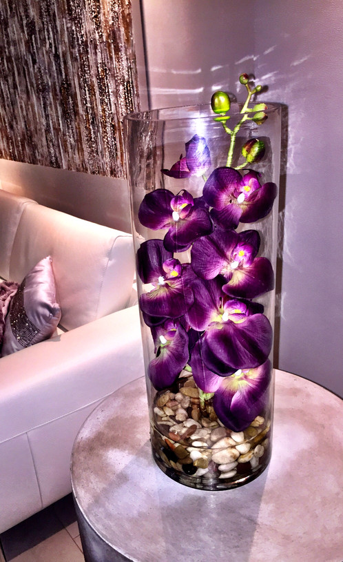This orchid arrangement is as realistic as they come... The cylinder glass  vase encloses an extremely realistic, waxy feeling, orchid stem that is  dipped ...