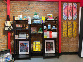 Our Foundation gift shop behind the staircase, featuring fine art books, gifts and original artwork and prints